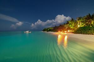 Soneva Fushi lagoon by moonlight