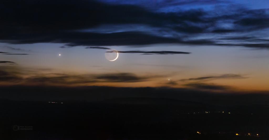 Celestial trio setting over horizon