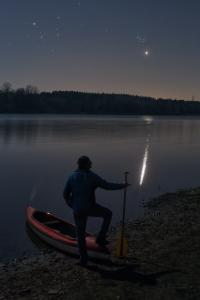 Canoeist stargazing